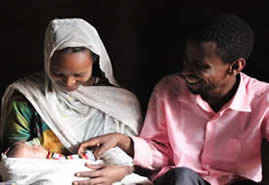 Nefisa and her husband with their two weeks old daughter